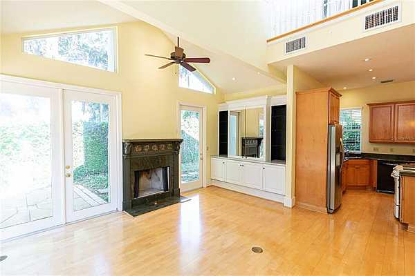 Photo #12 Great room opens to the kitchen