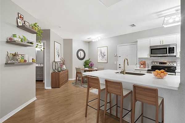 Photo #7 This 3rd floor unit has been COMPLETELY UPDATED with all the desirable MODERN details, plus wonderful COURTYARD VIEWS as well as amazing AMENITIES! Virtually Staged