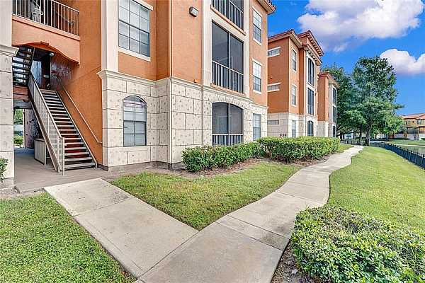 Photo #2 WELCOME to the GATED COMMUNITY of Serenata Condos in the heart of Orlando!