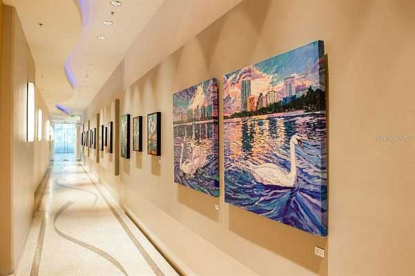 Photo #7 Art gallery on the walls walking towards elevators. Every few months, a different artists work is displayed!