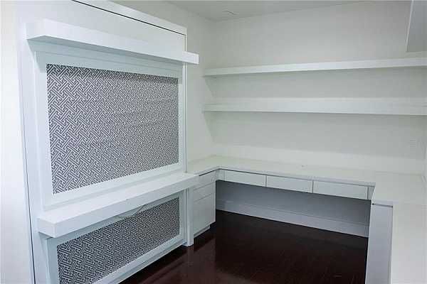 Photo #8 Study with built in shelving and Murphy bed
